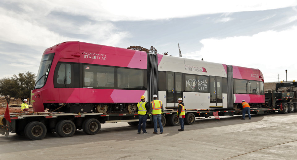 Photo - The flatbed carrying the streetcar was more than 60 feet long. It will make six more trips to Oklahoma City between now and July. [Photo by Steve Sisney, The Oklahoman]