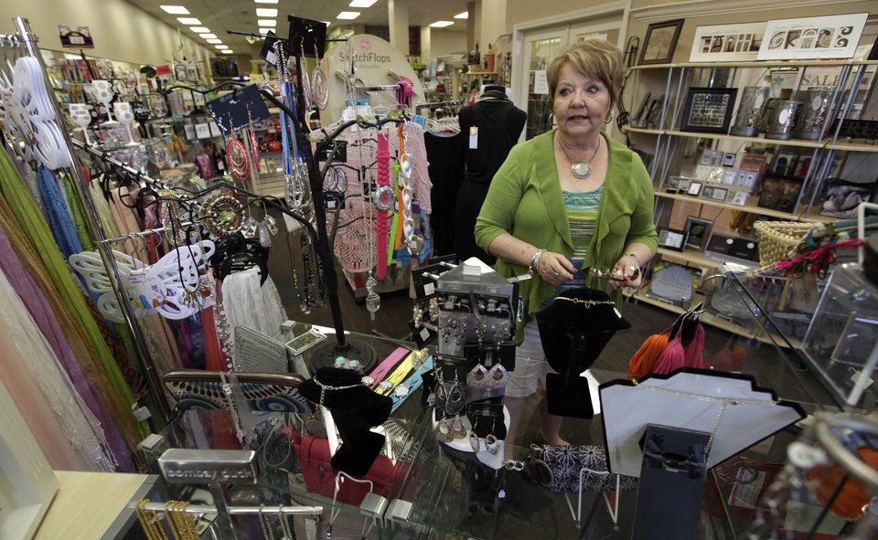 "In this Tuesday, June 19, 2012 photo, Alice Simons talks about the many items she has on display in one of her three stores in Carroll, Iowa. Mitt Romney�s private sector resume has impressed Simons. ""I do think he has a little more business sense than Obama does,"" she says. ""The one thing that really bugs me is people criticize Romney for having money. ... I just want to see successful people. ... I guess what I�m saying if they have made their money in private business, why wouldn�t we want somebody that has that sense and know-how?� (AP Photo/Charlie Neibergall)"