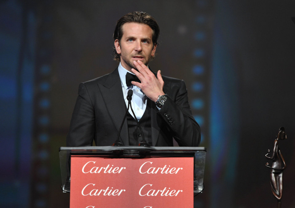 Photo - Bradley Cooper appears on stage at the 24th Annual Palm Springs International Film Festival Awards Gala on Saturday, Jan. 5, 2013 in Palm Springs, Calif. The gala honors individuals in the film industry with awards for acting, directing, achievement in film scoring and lifetime achievement. (Photo by John Shearer/Invision/AP Images)