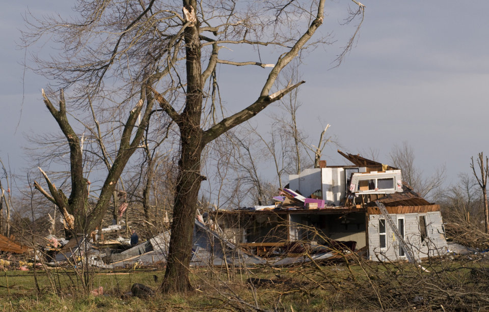 Residents of Marysville, Ind., survey the tornado damage to their homes Friday, March 2, 2012 in Marysville, Ind. (AP Photo/Brian Bohannon) ORG XMIT: KYBB115