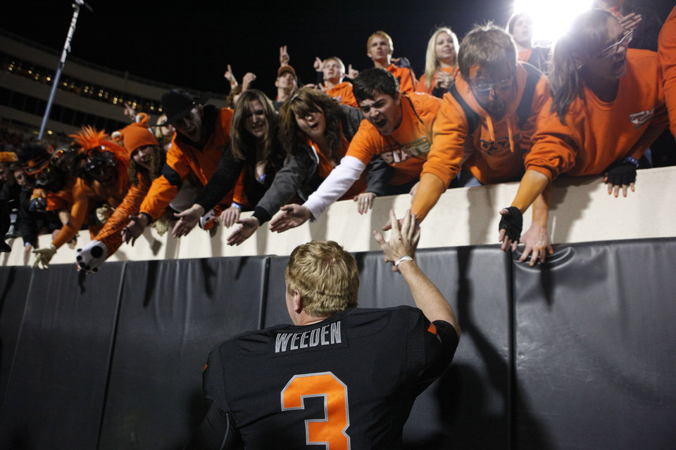 Photo - Oklahoma State's Brandon Weeden (3) celebrates with fans during a college football game between the Oklahoma State University Cowboys and the Kansas State University Wildcats at Boone Pickens Stadium in Stillwater, Okla., Saturday, Nov. 5, 2011.  Photo by Sarah Phipps, The Oklahoman