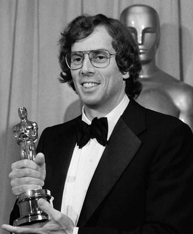 Photo -   FILE - In this April 3, 1978 file photo, songwriter Joseph Brooks smiles as he holds his Oscar for best original song for