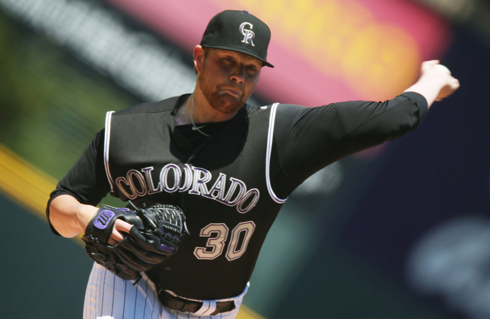 Photo - Making his first appearance since being activated off the 60-day disabled list, Colorado Rockies starting pitcher Brett Anderson works against the Minnesota Twins in the first inning of an interleague baseball game in Denver on Sunday, July 13, 2014. (AP Photo/David Zalubowski)