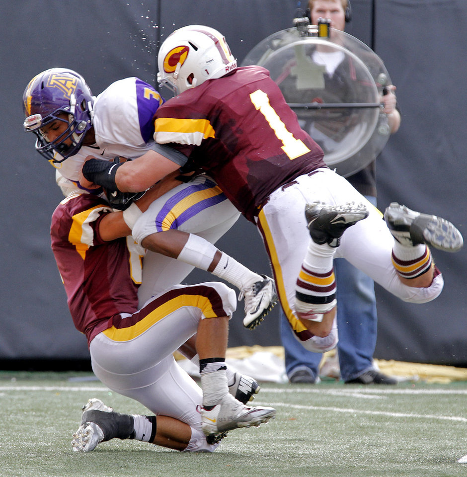 Clinton's Devon Mitchell (6) and Garrison Mendoza (1) stop Anadarko's Josh Parton (3) during the Class 4A Oklahoma state championship football game between Anadarko and Clinton at Boone Pickens Stadium on Saturday, Dec. 1, 2012, in Stillwater, Okla.   Photo by Chris Landsberger, The Oklahoman