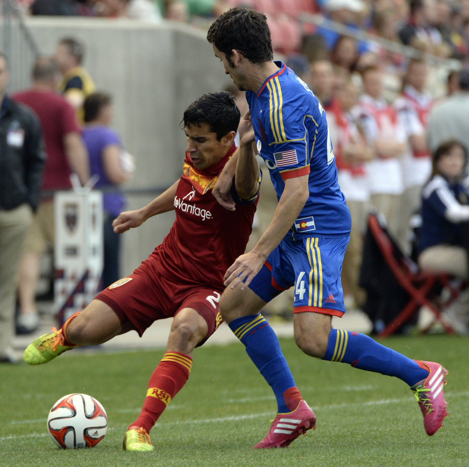 Photo - Real Salt Lake defender Tony Beltran, left, vies with Colorado Rapids midfielder/defender Nathan Sturgis (24) for the ball during an MLS soccer game Saturday, May 17, 2014, in Sandy, Utah. (AP Photo/The Salt Lake Tribune, Rick Egan)  LOCAL TV OUT  MAGS OUT  DESERET NEWS OUT