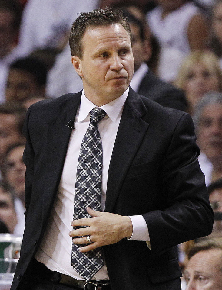 Photo -   Oklahoma City Thunder head coach Scott Brooks walks down the floor at a break during the first half at Game 3 of the NBA Finals basketball series against the Miami Heat, Sunday, June 17, 2012, in Miami. (AP Photo/Lynne Sladky)