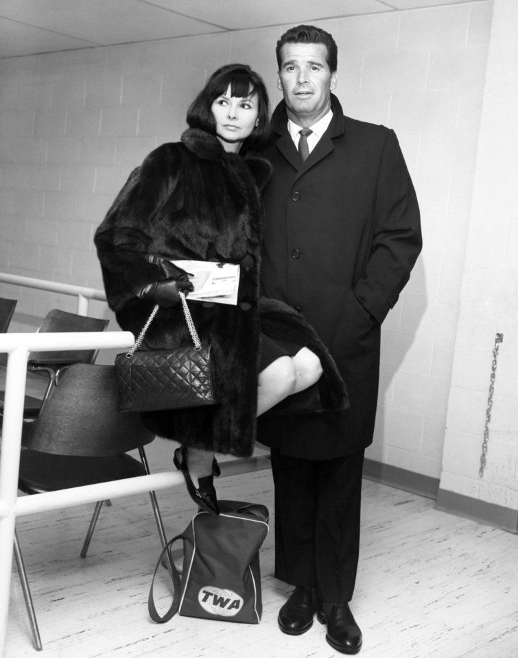 "Photo - FILE - Actor James Garner, right, and his wife Lois are shown in the Trans World Flight Center prior to boarding a TWA Jetliner enroute to London  in this Feb. 21, 1964 file photo taken in New York. Actor James Garner, wisecracking star of TV's ""Maverick"" who went on to a long career on both small and big screen, died Saturday July 19, 2014 according to Los angeles police. He was 86. (AP Photo/MGM, File) NO SALES"