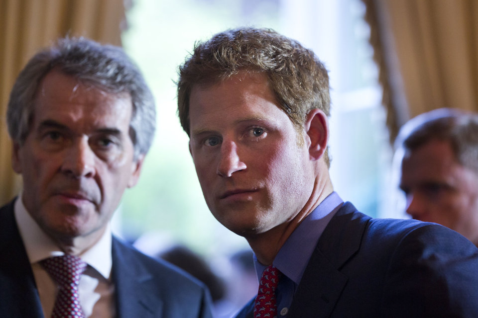 Photo - England's Prince Harry, right, speaks with British Ambassador Sir Peter Westmacott during a reception and dinner at the British Ambassador's residence, Thursday, May 9, 2013 in Washington. (AP Photo/Jim Lo Scalzo, Pool)