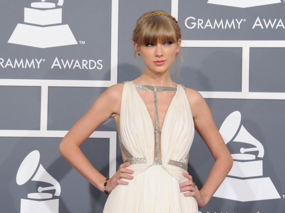 Photo - Taylor Swift arrives at the 55th annual Grammy Awards on Sunday, Feb. 10, 2013, in Los Angeles.  (Photo by Jordan Strauss/Invision/AP)