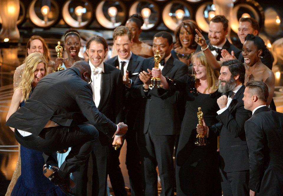 Photo - Director Steve McQueen, left, celebrates with the cast and crew of