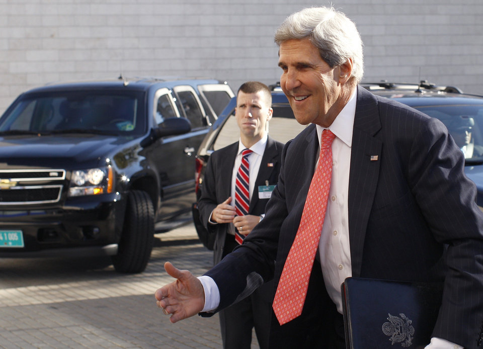 Photo - United States Secretary of State John Kerry arrives for an informal meeting of EU ministers for foreign affairs in the National Art Gallery  in Vilnius, Lithuania, Saturday, Sept. 7, 2013.  Kerry is in Europe courting international support for a possible U.S. strike on the Syrian regime for its alleged use of chemical weapons.  (AP Photo/Mindaugas Kulbis)