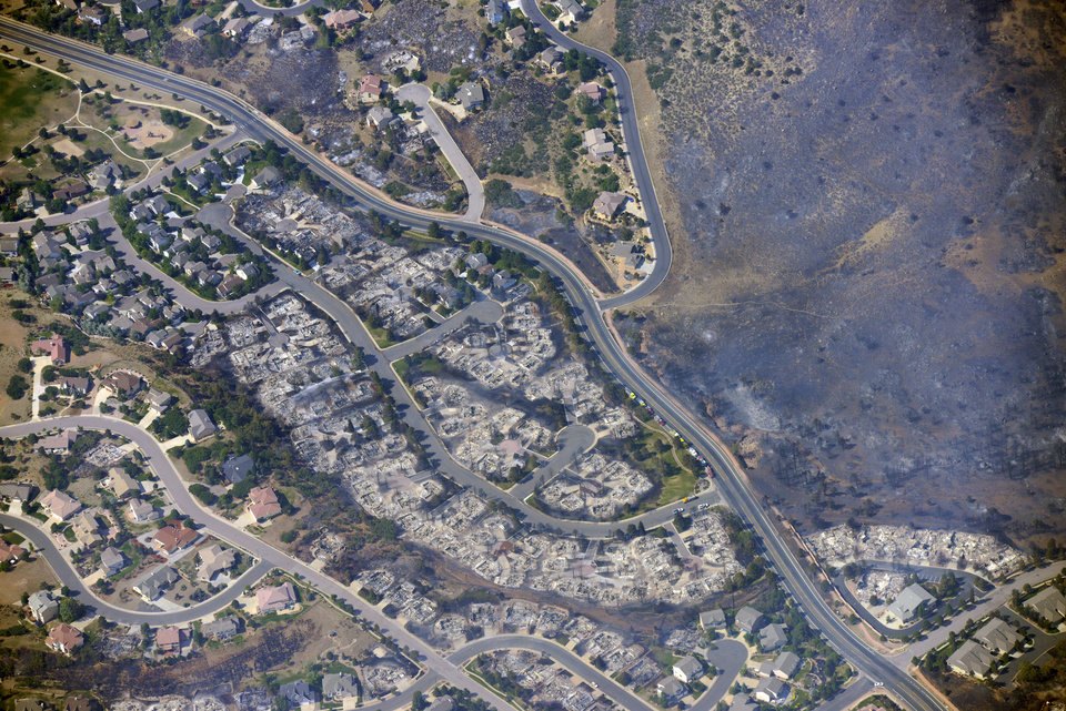 Photo -   This aerial photo taken on Wednesday, June 27, 2012, shows burned homes in the Mountain Shadows residential area of Colorado Springs, Colo., that were destroyed by the Waldo Canyon wildfire. More than 30,000 have been displaced by the fire, including thousands who frantically packed up belongings Tuesday night after it barreled into neighborhoods in the foothills west and north of Colorado's second-largest city. (AP Photo/John Wark)