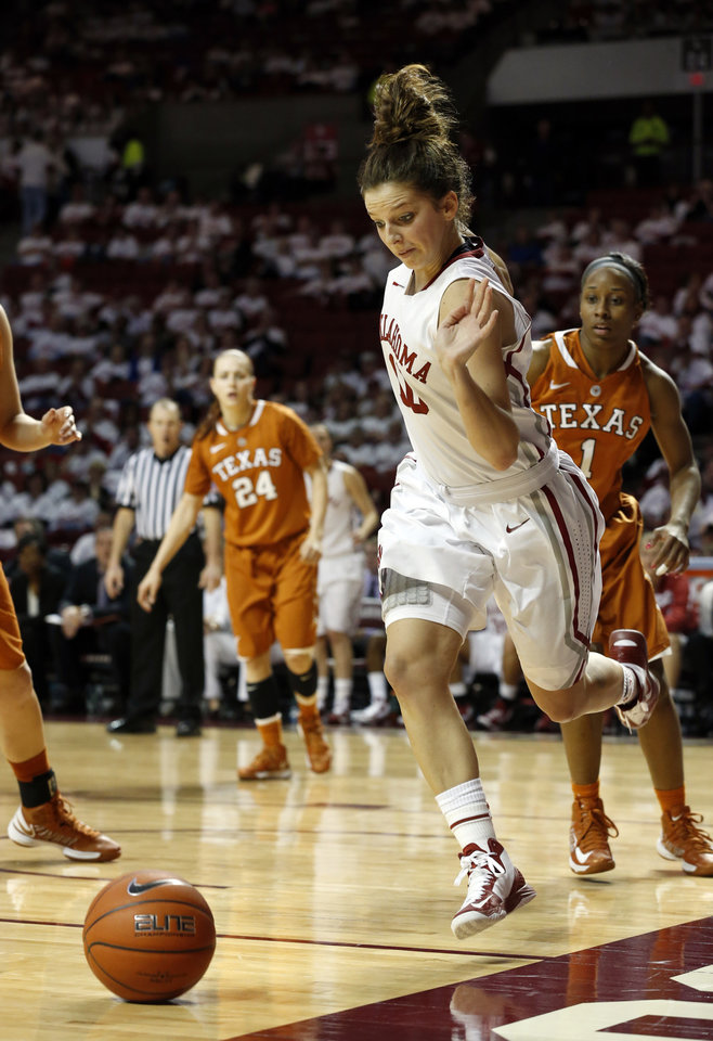 Oklahoma Sooners' Morgan Hook (10) saves a ball from going out of bounds on a pass in the second half as the University of Oklahoma Sooners (OU) defeat the University of Texas (UT) Longhorns 69-56 in NCAA, women's college basketball at The Lloyd Noble Center on Saturday, Jan. 19, 2013 in Norman, Okla. Photo by Steve Sisney, The Oklahoman