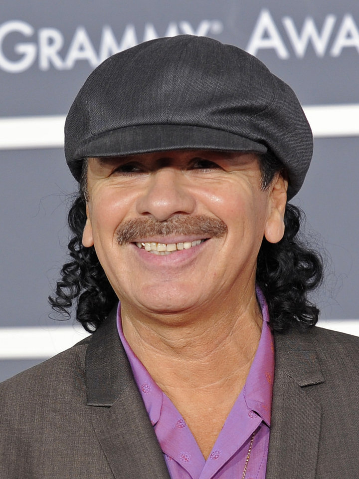 Photo - FILE - In this Jan. 31, 2010 file photo, Carlos Santana arrive at the Grammy Awards in Los Angeles. (AP Photo/Chris Pizzello, file) ORG XMIT: NYET530