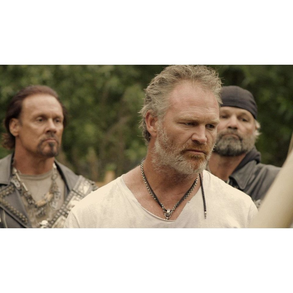 "Brian Bosworth, center, in ""Revelation Road 2."" <strong></strong>"