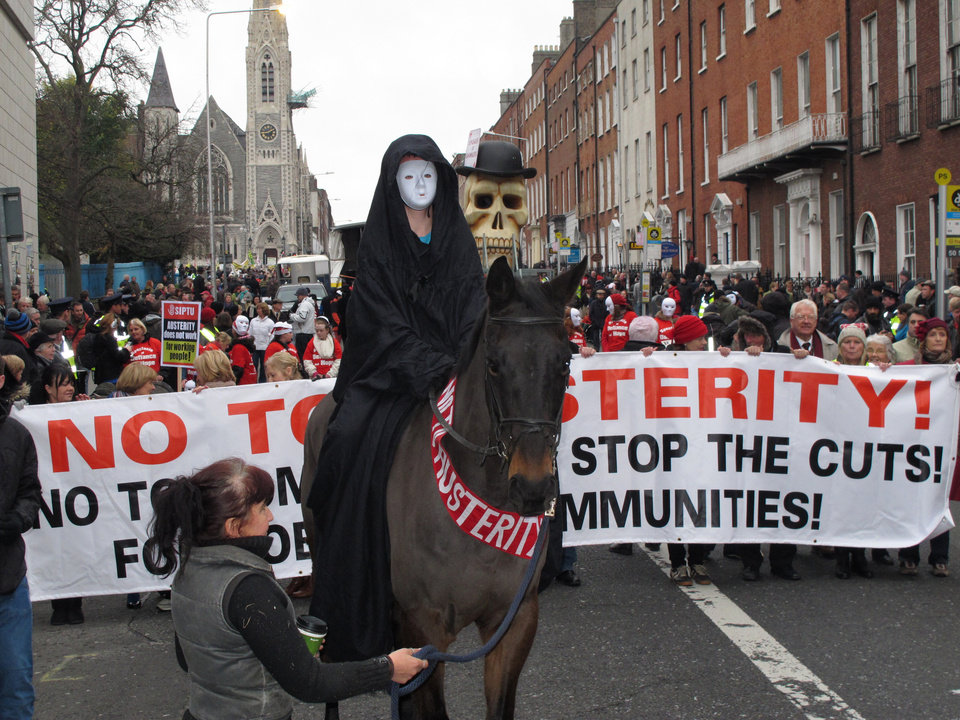 A masked rider on horseback depicting Death leads an anti-austerity protest march in Dublin, Ireland, on Saturday, Nov. 24, 2012. The government says it will unveil Ireland\'s sixth straight austerity budget next month in hopes of reducing the country\'s 2013 deficit to 8.6 percent, still nearly triple the spending limit that eurozone members are supposed to observe. (AP Photo/Shawn Pogatchnik)