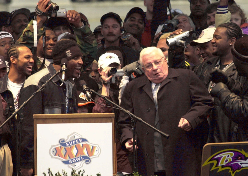 Photo -   FILE - This Jan. 30, 2001 file photo shows Baltimore Ravens owner Art Modell, right, dancing with Super Bowl Most Valuable Player Ray Lewis, left foreground, as members of the team react during the celebration following the Ravens Super Bowl victory parade at City Hall in Baltimore. Former Ravens owner Modell has died. He was 87. The team said Modell died of natural causes early Thursday, Sept. 6, 2012, at Johns Hopkins Hospital, where he had been admitted Wednesday.(AP Photo/Chris Gardner, File)