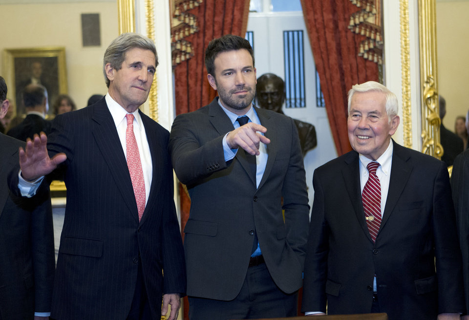 Photo - Sen. John Kerry D-Mass.,  shakes hands with actor Ben Affleck during a meeting with foreign relations members to discus the crisis in the Democratic Republic of Congo on Capitol Hill in Washington on Wednesday, Dec. 19, 2012. With them is Sen. Richard Lugar R-IN., right. (AP Photo/Jose Luis Magana)