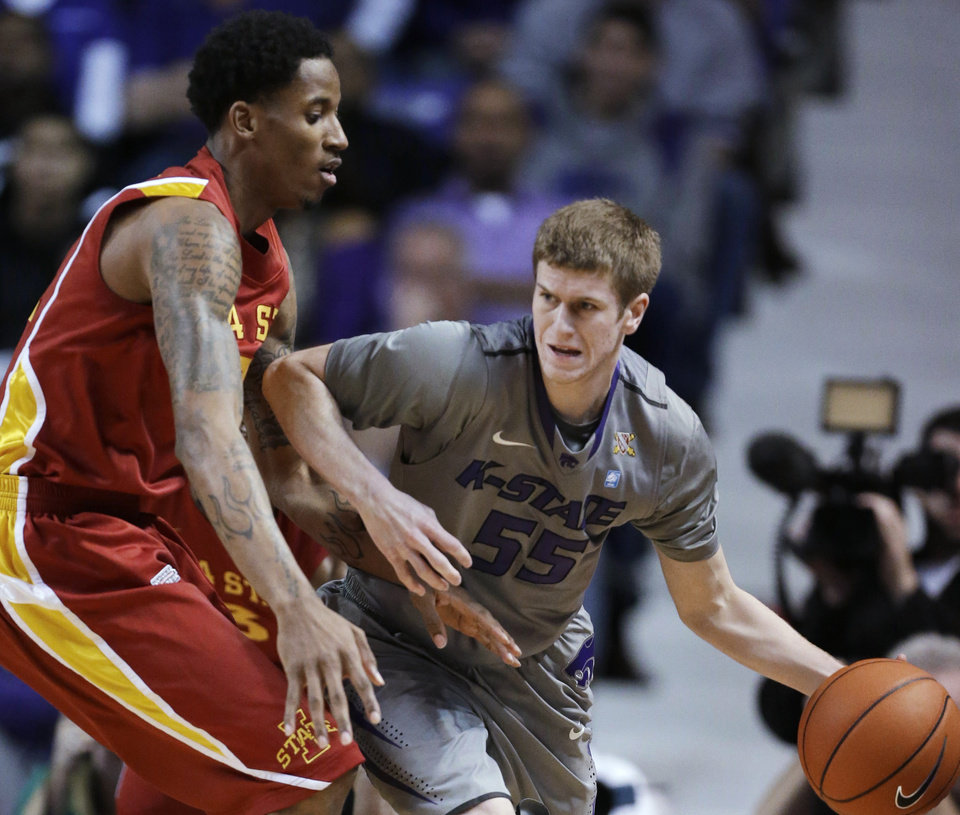 Kansas State guard Will Spradling (55) works against Iowa State guard Will Clyburn (21) during the first half of an NCAA college basketball game in Manhattan, Kan., Saturday, Feb. 9, 2013. (AP Photo/Orlin Wagner)