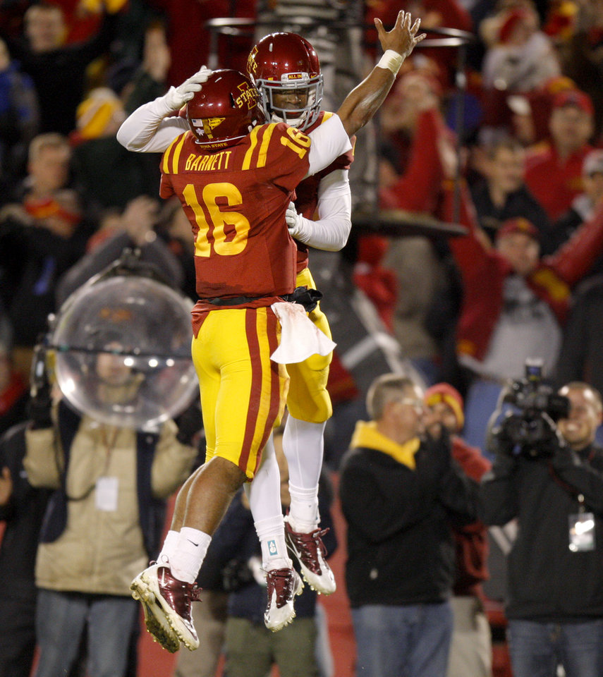Photo - Iowa State's Jared Barnett (16) celebrates with Darius Reynolds (7) after a touchdown during a college football game between the Oklahoma State University Cowboys (OSU) and the Iowa State University Cyclones (ISU) at Jack Trice Stadium in Ames, Iowa, Friday, Nov. 18, 2011. Photo by Bryan Terry, The Oklahoman