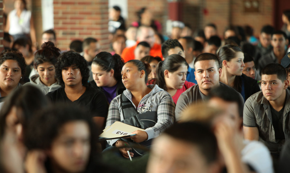 Photo -   Undocumented people wait to fill out application forms for the Obama administration's Deferred Action for Childhood Arrivals program on Wednesday, Aug. 15, 2012 at Navy Pier in Chicago. (AP Photo/Sitthixay Ditthavong)