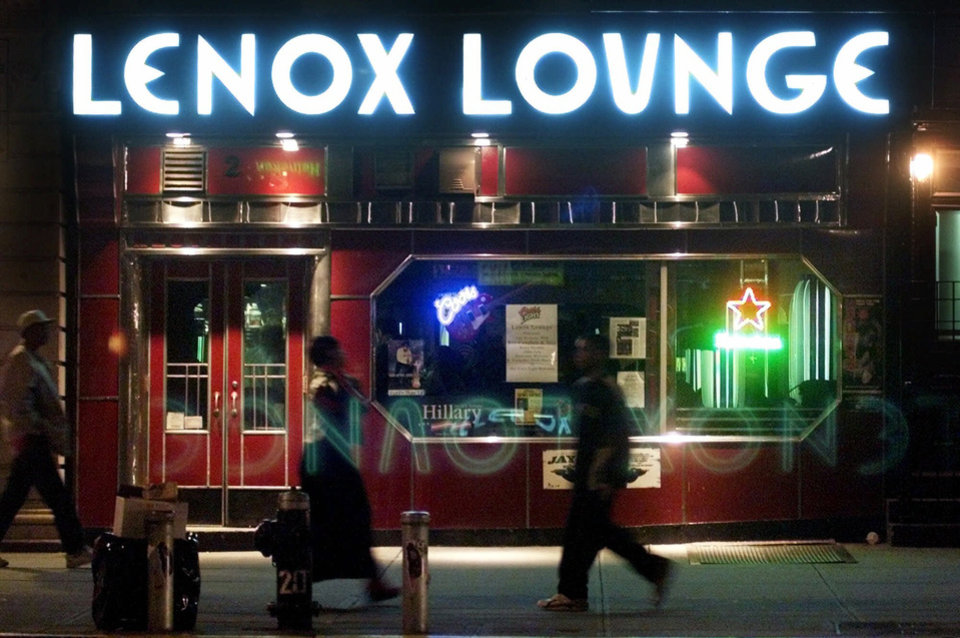 FILE - In this Oct. 19, 2000 file photo, pedestrians pass by the Lenox Lounge in the Harlem neighborhood of New York. Longtime owner Alvin Reed says that the Harlem cabaret with a supercool, Art Deco style that made it a favorite of jazz greats like Billie Holiday, Miles Davis and John Coltrane, is closing its doors on New Year\'s Eve. (AP Photo/Suzanne Plunkett, File)