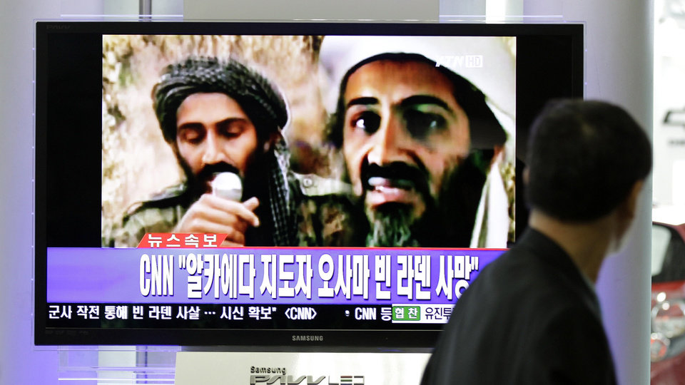 Photo - A man watches a TV broadcast on the death of Osama bin Laden at Seoul train station in Seoul, South Korea, Monday, May 2, 2011. Osama bin Laden, the glowering mastermind behind the Sept. 11, 2001, terror attacks that killed thousands of Americans, was killed in an operation led by the United States, President Barack Obama said Sunday. The Korean read: