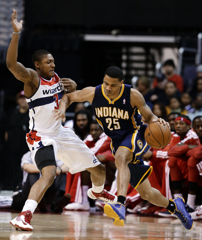 Washington Wizards forward Trevor Ariza guards Indiana Pacers forward Gerald Green during the first half of an NBA basketball game Monday, Nov. 19, 2012, in Washington. (AP Photo/Alex Brandon)