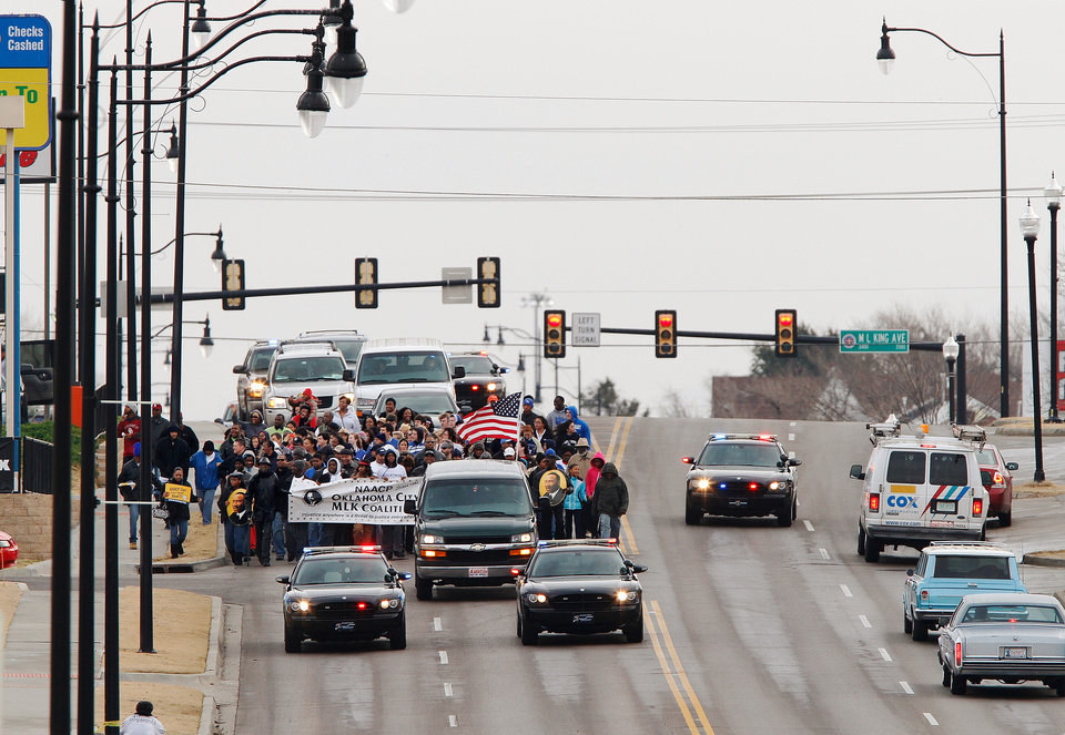 Participants in the Silent March carry a banner in front of their group as they walk west on NE 23 from Martin Luther King Ave; it is one of several events in the Oklahoma City area that allowed local residents to observe the national holiday honoring slain civil rights leader, Dr. Rev. Martin Luther King, Jr. on Monday, Jan. 16, 2012, Photo by Jim Beckel, The Oklahoman