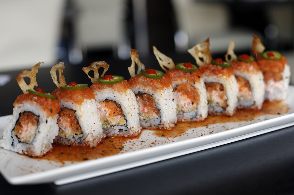 Photo - The lotus on fire roll is pictured at Cafe Icon in Edmond. Photo by Sarah Phipps, The Oklahoman  SARAH PHIPPS - SARAH PHIPPS