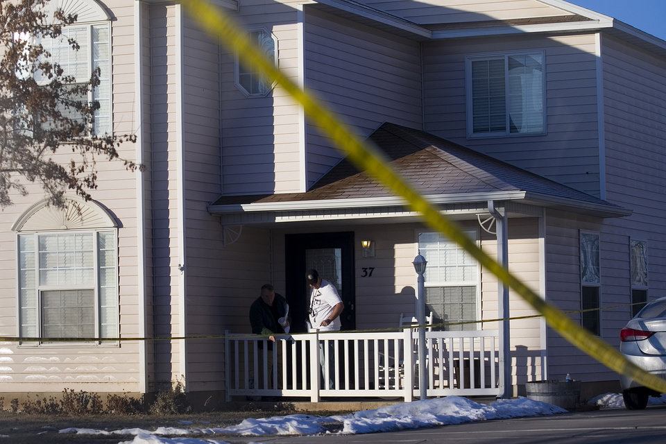 Photo - Police investigate a home, Friday, Jan. 17, 2014, in Spanish Fork, Utah where five people were found dead on Thursday.  A 34-year-old officer shot and killed his wife, mother-in-law and two young children and turned the gun on himself, authorities said Friday.  Spanish Fork police said the five were found dead about 11 p.m. Thursday, when co-workers reported Joshua Boren didn't show up for his night shift as a patrol officer at the Lindon Police Department. (AP Photo/Daily Herald, Mark Johnston)