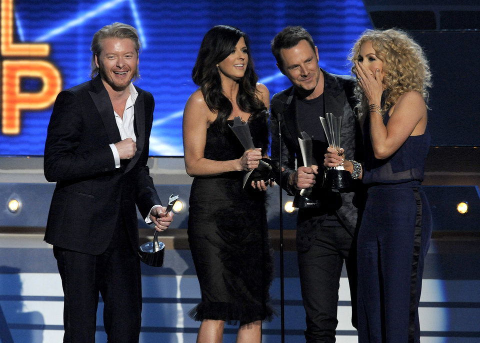 From left, Phillip Sweet, Karen Fairchild, Jimi Westbrook and Kimberly Schlapman, of musical group Little Big Town, accept the award for vocal group of the year at the 48th Annual Academy of Country Music Awards at the MGM Grand Garden Arena in Las Vegas on Sunday, April 7, 2013. (Photo by Chris Pizzello/Invision/AP) ORG XMIT: NVPM269