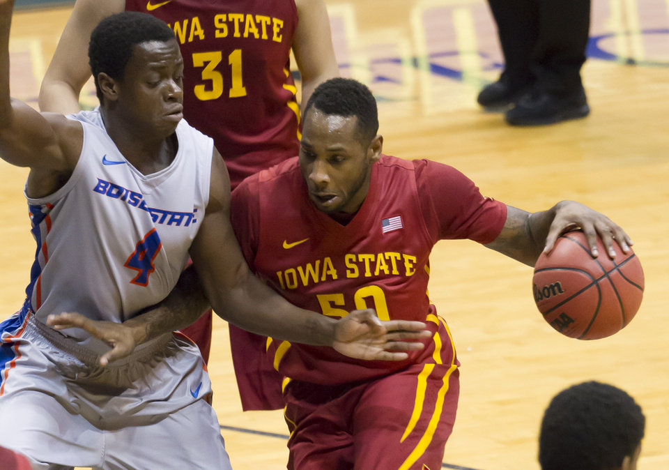 Photo - Iowa State guard DeAndre Kane (50) drives to the basket as Boise State guard Thomas Bropleh (4) defends during the first half of an NCAA college basketball game at the Diamond Head Classic on  Wednesday, Dec. 25, 2013, in Honolulu. Iowa State won 70-66. (AP Photo/Eugene Tanner)