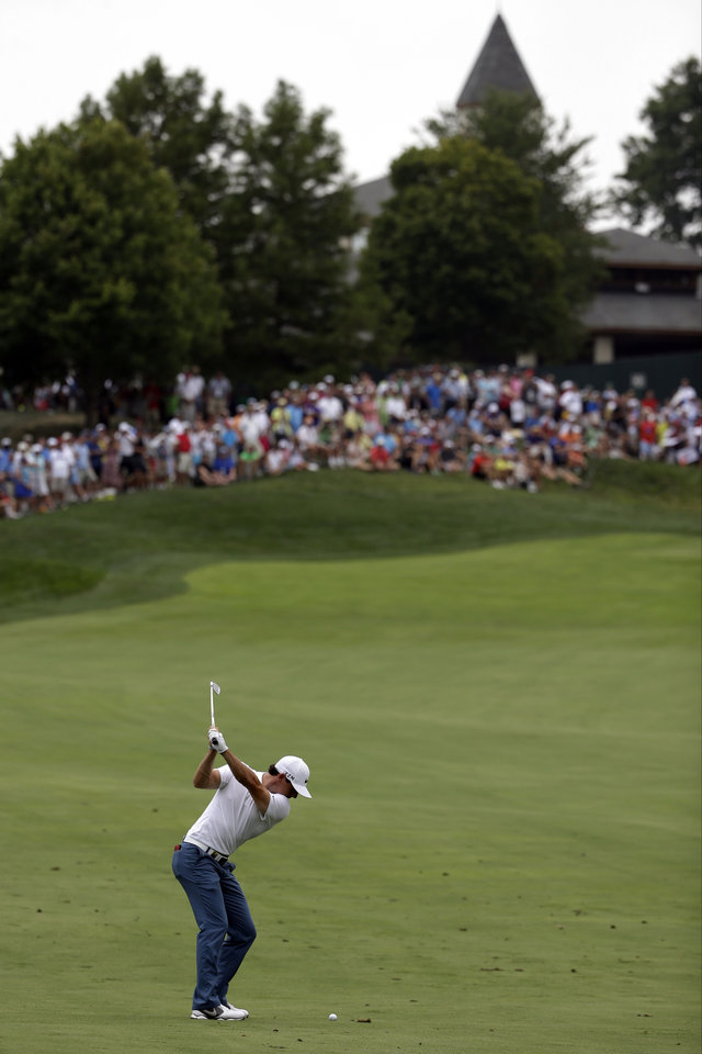 Photo - Rory McIlroy, of Northern Ireland, hits from the fairway on the ninth hole during a practice round for the PGA Championship golf tournament at Valhalla Golf Club on Tuesday, Aug. 5, 2014, in Louisville, Ky. The tournament is set to begin on Thursday. (AP Photo/David J. Phillip)