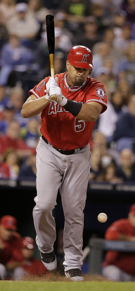Photo -   Los Angeles Angels' Albert Pujols is hit by a pitch thrown by Kansas City Royals relief pitcher Tim Collins during the eighth inning of a baseball game on Friday, Sept. 14, 2012, in Kansas City, Mo. (AP Photo/Charlie Riedel)