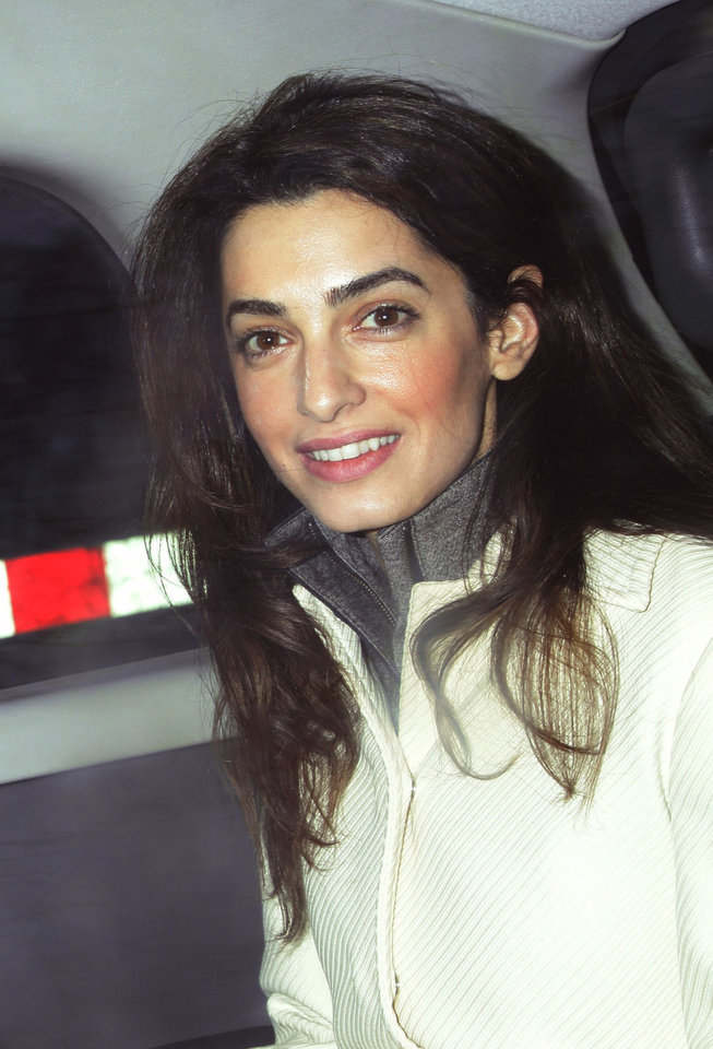Photo - FILE - This Feb. 7, 2011 file photo shows human rights attorney Amal Alamuddin, in London. Hollywood's most determined bachelor, George Clooney, recently proposed to the 36-year-old Alamuddin, despite repeated protestations that marriage wasn't for him.  A spokesman for the Oscar-winning actor and producer did not respond to requests for comment Monday, April 28, 2014.  (AP Photo/PA, Yui Mok, File)  UNITED KINGDOM OUT  NO SALES  NO ARCHIVE