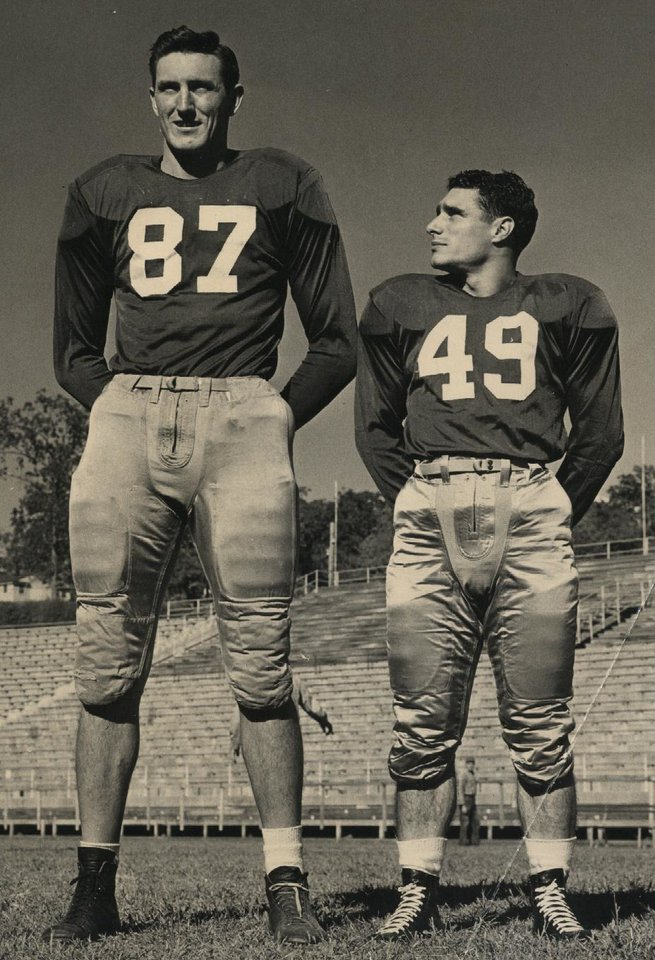 Photo - A WWII vet, Bob Ambler (left) went on the GI Bill to the University of Arkansas, where he lettered in football, basketball and track. He was 6 feet 8 inches tall and weighed 225 pounds.   - PHOTO PROVIDED