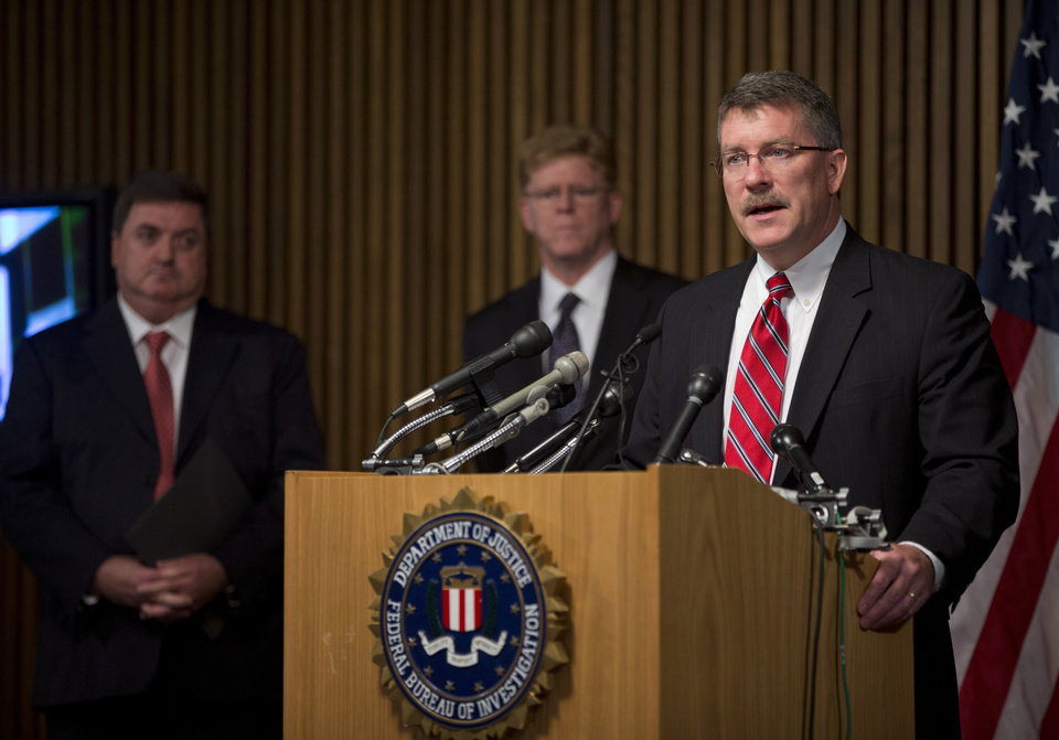 Photo - Ron Hosko, assistant director of the FBI's Criminal Investigative Division, right, speaks during a news conference at FBI headquarters in Washingotn, Monday, July 29, 2013,  about