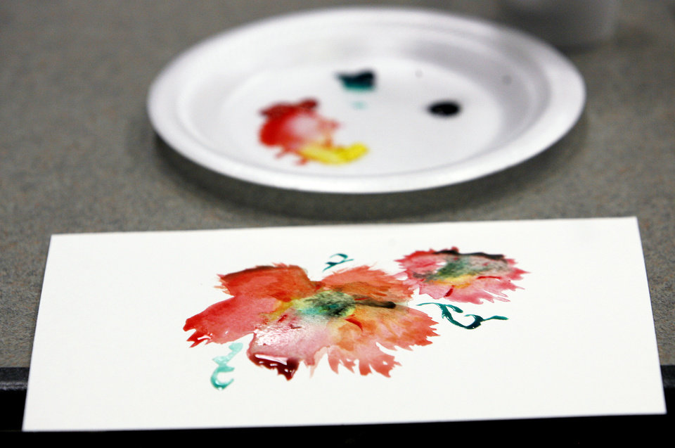 Photo - Students chose from a variety of paint colors to create their art.