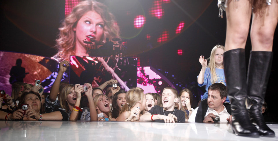 Photo - Fans cheer as Taylor Swift sings during the Fearless tour concert, Wednesday, March, 31, 2010, at the Ford Center in Oklahoma City. Photo by Sarah Phipps, The Oklahoman