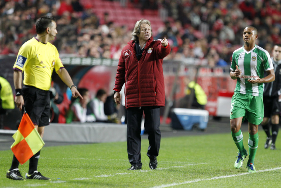 Coach Jorge Jesus, center, gives instructions inside Benfica's team box area during the Portuguese league soccer match between Benfica and Rio Ave at Benfica's Luz stadium in Lisbon, Saturday, March 30, 2013. Benfica defeated Rio Ave 6-1. (AP Photo/Francisco Seco)