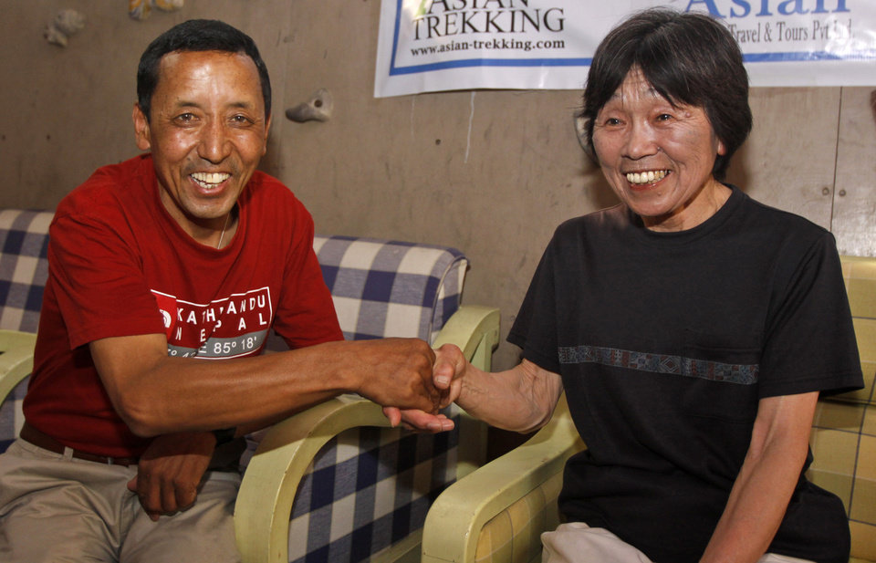 Photo -   Oldest woman climber of Mount Everest, Tamae Watanabe of Japan, right, is greeted by Nepal's Apa Sherpa, after arriving in Katmandu, Nepal, Friday, May 25, 2012. Watanabe, 73, has made history by becoming the oldest woman to scale the world's highest mountain, Mount Everest, bettering a record, she herself set a decade ago. (AP Photo/Binod Joshi)