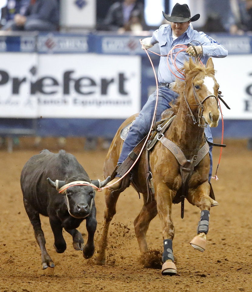 Photo - Jordan Ketscher of Squaw Valley, California, competes in the heading event during the Timed Event Championship inside the Lazy E Arena in Guthrie, Okla., Friday, March 13, 2020. [Bryan Terry/The Oklahoman]