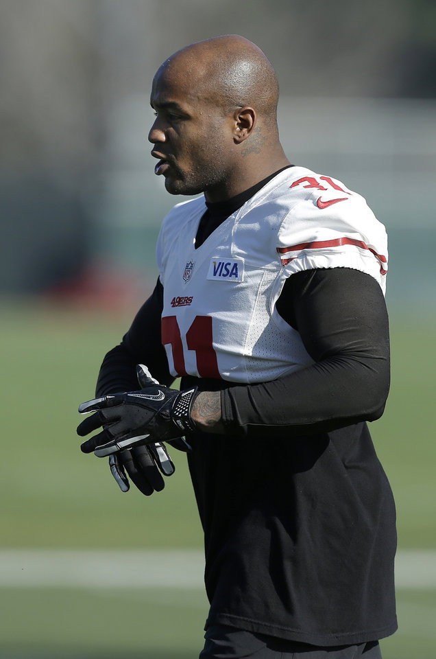 Photo - San Francisco 49ers safety Donte Whitner practices at an NFL football training facility in Santa Clara, Calif., Friday, Jan. 25, 2013. The 49ers are scheduled to play the Baltimore Ravens in the Super Bowl on Sunday, Feb. 3. (AP Photo/Jeff Chiu)