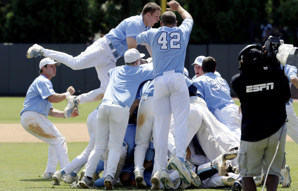 Photo - North Carolina players celebrate following their 5-4 win over South Carolina in an NCAA college baseball tournament super regional game in Chapel Hill, N.C., Tuesday, June 11, 2013. North Carolina advances to the College World Series. (AP Photo/Gerry Broome)
