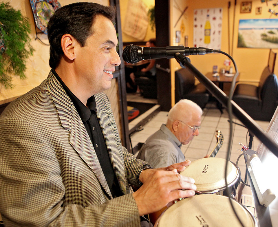 Jim Mitchell (right) and Jonathan Mende'  of the group Jim-n-I perform at Zarate's Latin Mexican Grill in Edmond on  Tuesday, July 27, 2009. By John Clanton, The Oklahoman