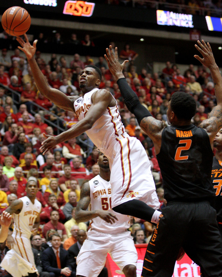 Photo - Iowa State forward Melvin Ejim puts up an off blanace shot over Oklahoma State guard/forward Le'Bryan Nash (2) during the second half of an NCAA college basketball game in Ames, Iowa, Saturday, March 8, 2014. (AP Photo/Justin Hayworth)