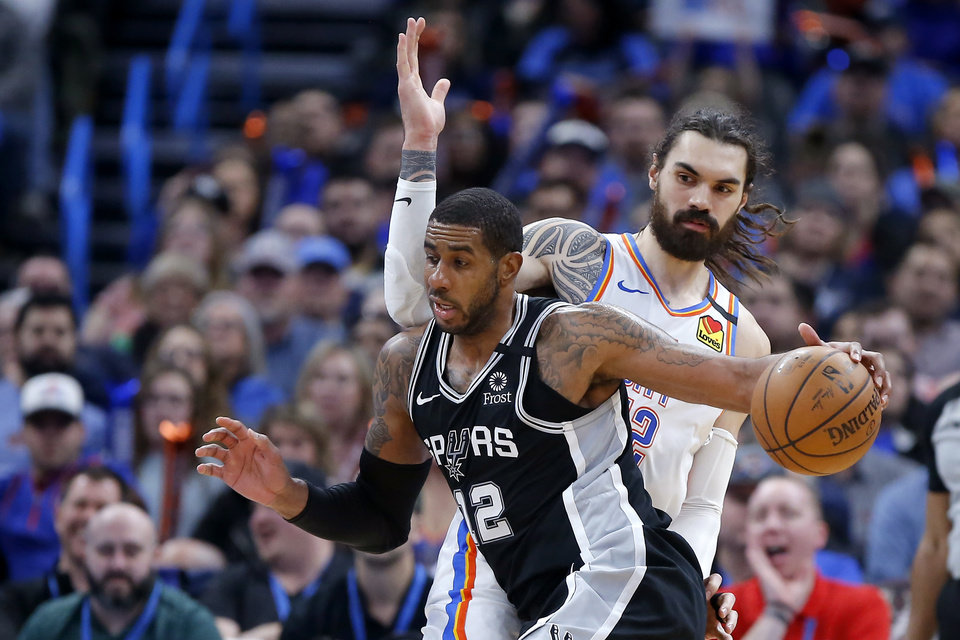 Photo - San Antonio's LaMarcus Aldridge (12) goes past Oklahoma City's Steven Adams (12) during an NBA basketball game between the Oklahoma City Thunder and the San Antonio Spurs at Chesapeake Energy Arena in Oklahoma City, Tuesday, Feb. 11, 2020. [Bryan Terry/The Oklahoman]