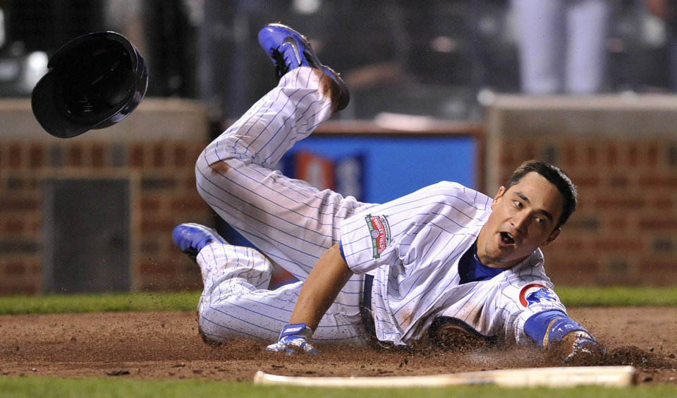 Photo - Chicago Cubs' Darwin Barney scores on an Eli Whiteside double during the seventh inning of a baseball game against the Pittsburgh Pirates in Chicago, Saturday, June 21, 2014. (AP Photo/Paul Beaty)
