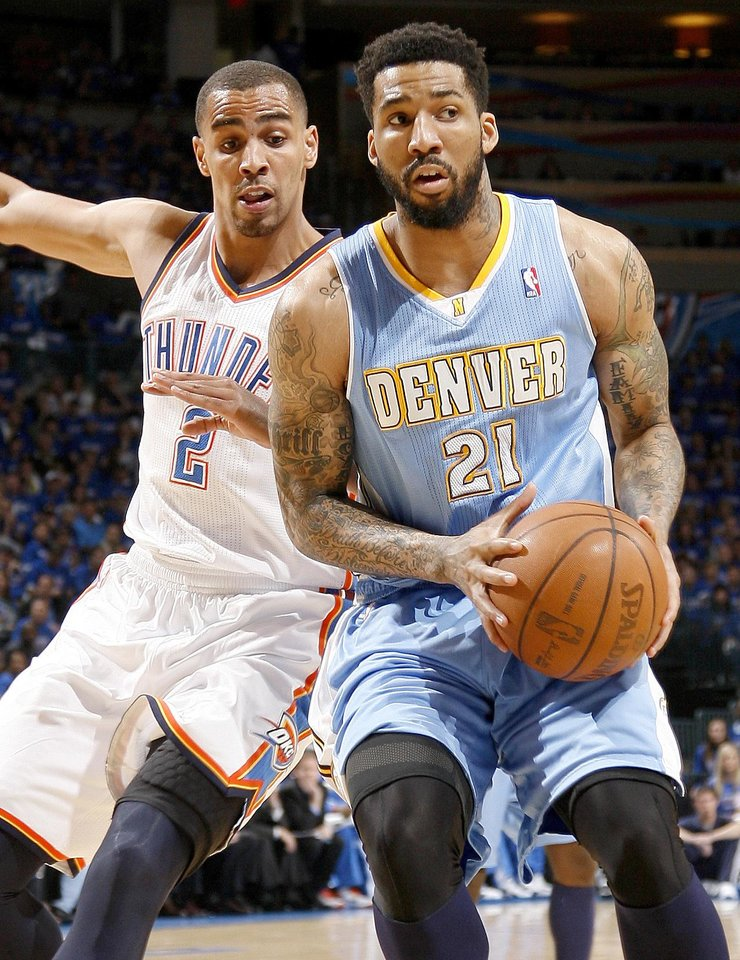 Oklahoma City's Thabo Sefolosha (2) defends Denver's Wilson Chandler (21) during the NBA basketball game between the Denver Nuggets and the Oklahoma City Thunder in the first round of the NBA playoffs at the Oklahoma City Arena, Sunday, April 17, 2011. Photo by Bryan Terry, The Oklahoman